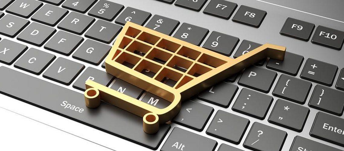 E shop, e commerce concept. Shopping cart trolley icon on a computer laptop. 3d illustration
